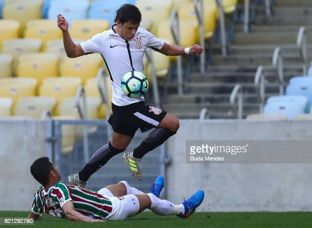 Renato Junior of Fluminense struggles for the ball with Angel Romero of Corinthians during a match between Fluminense and Corinthians as part of...