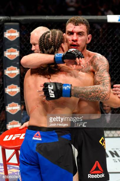 Renato Moicano of Brazil and Brian Ortega embrace after their featherweight bout during the UFC 214 event at Honda Center on July 29 2017 in Anaheim...