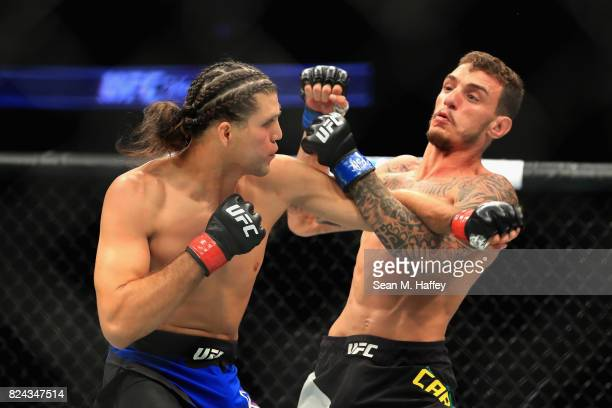 Renato Moicano of Brazil fights Brian Ortega during their Featherweight bout at UFC 214 at Honda Center on July 29 2017 in Anaheim California