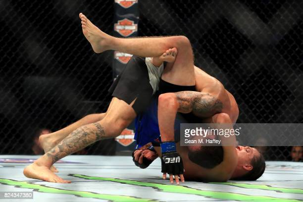 Renato Moicano of Brazil is defeated by Brian Ortega during their Featherweight bout at UFC 214 at Honda Center on July 29 2017 in Anaheim California