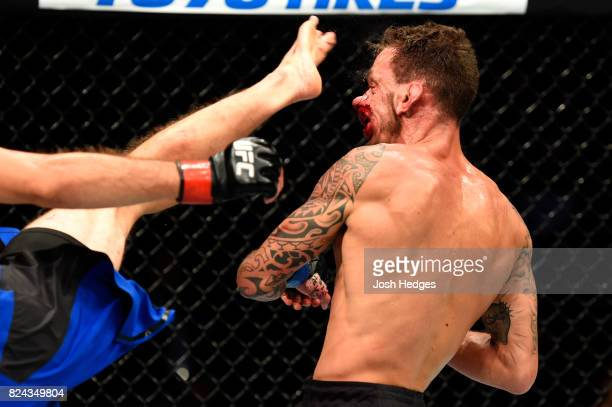 Renato Moicano of Brazil is kicked by Brian Ortega in their featherweight bout during the UFC 214 event at Honda Center on July 29 2017 in Anaheim...