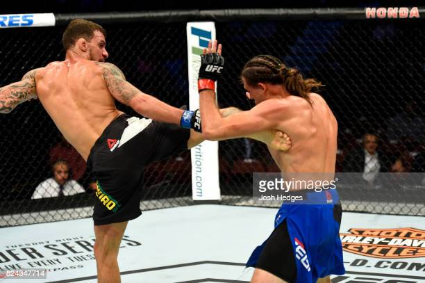 Renato Moicano of Brazil kicks Brian Ortega in their featherweight bout during the UFC 214 event at Honda Center on July 29 2017 in Anaheim California
