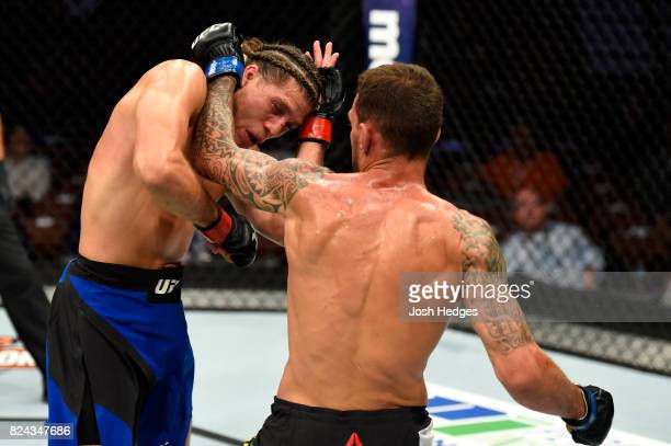 Renato Moicano of Brazil punches Brian Ortega in their featherweight bout during the UFC 214 event at Honda Center on July 29 2017 in Anaheim...