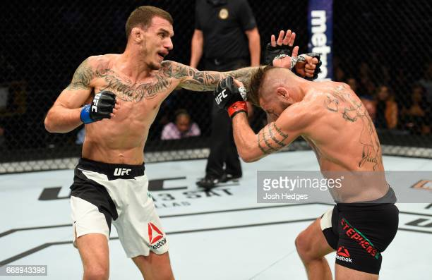 Renato Moicano of Brazil punches Jeremy Stephens in their featherweight fight during the UFC Fight Night event at Sprint Center on April 15 2017 in...