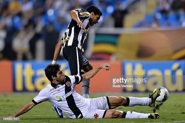 Renato of Botafogo and Juninho Pernambucano of Vasco struggle for the ball during a match between Botafogo and Vasco as part of the Brazilian...