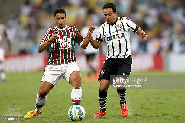 Renato of Fluminense and Jadson of Corinthians battle for control of the ball during their Brasileirao Series A 2015 match at Maracana Stadium on May...