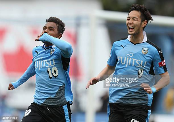 Renato of Kawasaki Frontale celebrates scoring his team's second goal with his team mate Kenyu Sugimoto during the JLeague match between Kawasaki...