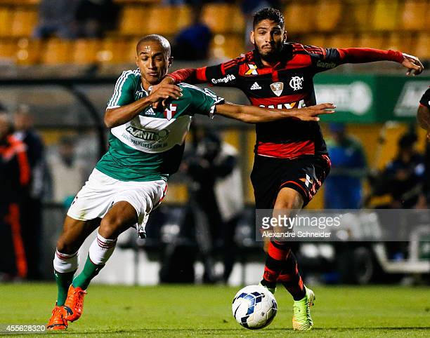 Renato of Palmeiras and Wallace of Flamengo in action during the match between Palmeiras e Flamengo for the Brazilian Series A 2014 at Pacaembu...