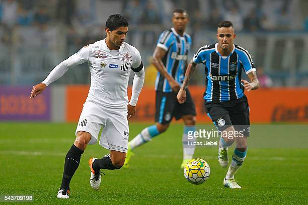 Renato of Santos battles for the ball against Luan of Gremio during the match Gremio v Santos as part of Brasileirao Series A 2016 at Arena do Gremio...