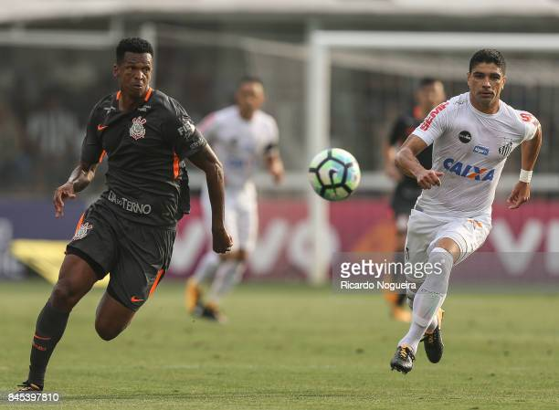 Renato of Santos battles for the ball with Jo of Corinthians during the match between Santos and Corinthians as a part of Campeonato Brasileiro 2017...