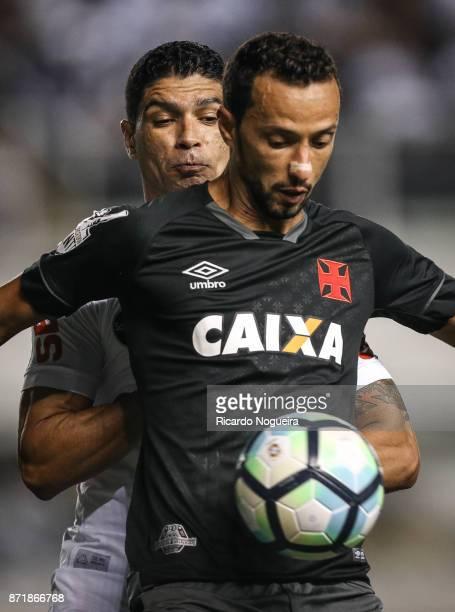 Renato of Santos battles for the ball with Nene of Vasco during the match between Santos and Vasco da Gama as a part of Campeonato Brasileiro 2017 at...