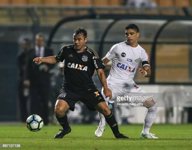Renato of Santos battles for the ball with Renato Caja of Ponte Preta during the match between Santos and Ponte Preta as a part of Campeonato...