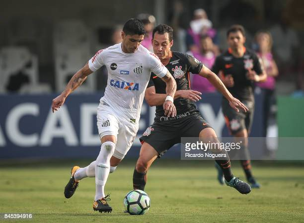 Renato of Santos battles for the ball with Rodriguinho of Corinthains during the match between Santos and Corinthians as a part of Campeonato...