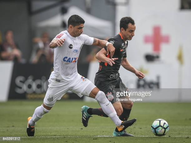 Renato of Santos battles for the ball with Rodriguinho of Corinthians during the match between Santos and Corinthians as a part of Campeonato...