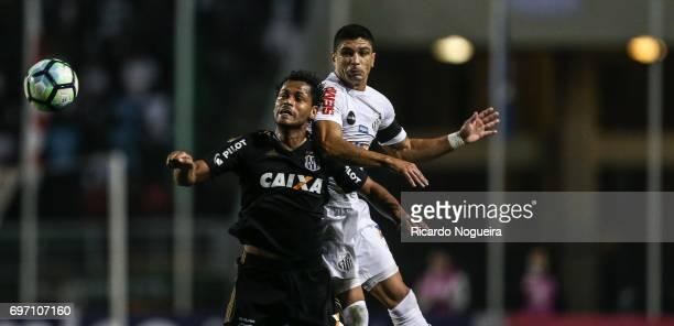 Renato of Santos wins a header with Elton of ponte Preta during the match between Santos and Ponte Preta as a part of Campeonato Brasileiro 2017 at...