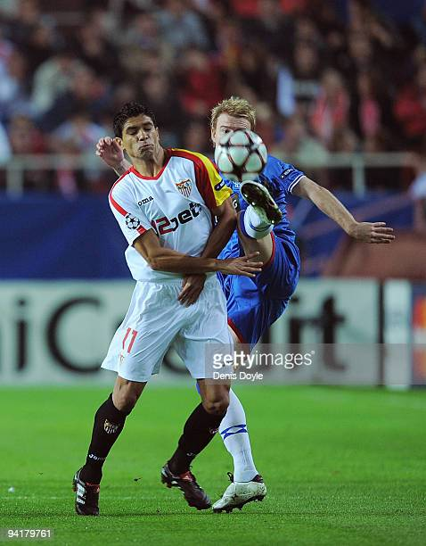 Renato of Sevilla is tackled by Steven Smith of Rangers FC during the UEFA Champions League Group G match between Sevilla and Rangers FC at the...