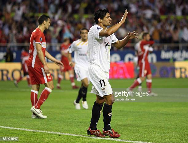Renato of Sevilla reacts after scoring Sevilla's second goal with his during the UEFA Cup group stage match between Sevilla and Vfb Stuttgart at the...