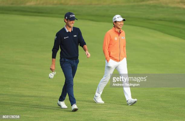 Renato Paratore of Italy and Jeunghun Wang of South Korea walk down the 10th fairway during day one of the HNA Open de France at Le Golf National on...
