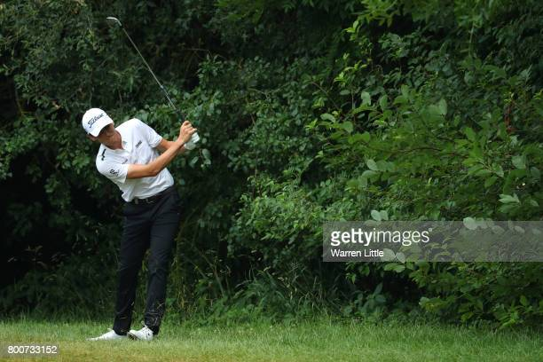Renato Paratore of Italy hits his second shot on the 10th hole during the final round of the BMW International Open at Golfclub Munchen Eichenried on...
