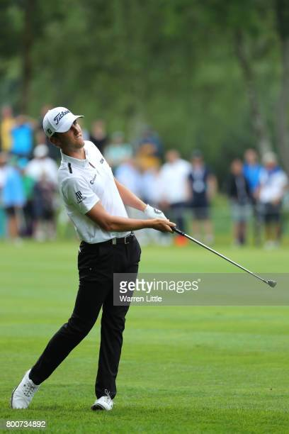 Renato Paratore of Italy hits his second shot on the 11th hole during the final round of the BMW International Open at Golfclub Munchen Eichenried on...