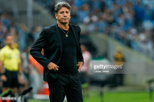 Renato Portaluppi coach of Gremio battles for the ball against Matheus Fernandes of Botafogo during the match between Gremio and Botafogo as part of...