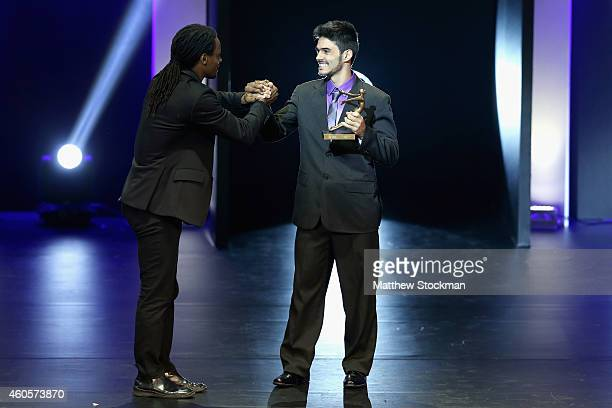 Renato Rezende BMX Athlete of the Year shakes hands with Toni Garrido during the Brazil Olympics Awards Ceremony at Theatro Municipal on December 16...
