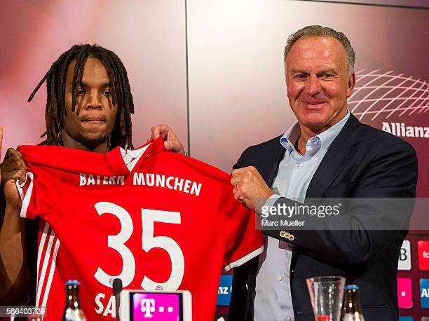 Renato Sanches and KarlHeinz Rummenigge are seen during a press conference of FC Bayern Munich at Allianz Arena on August 6 2016 in Munich Germany