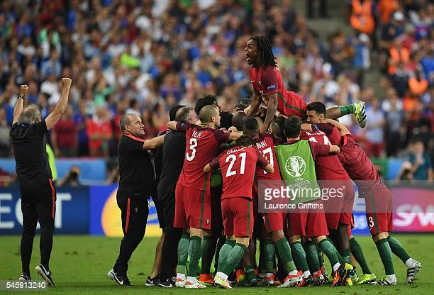 Renato Sanches and Portugal players celebrate their team's first goal during the UEFA EURO 2016 Final match between Portugal and France at Stade de...