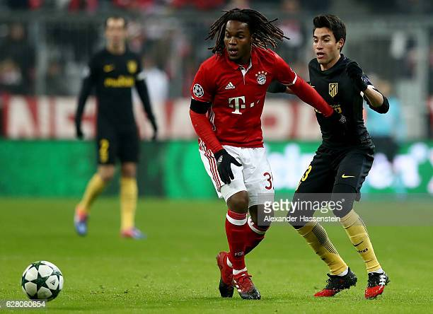 Renato Sanches of Bayern battles for the ball with Nicolas Gaitan of Atletico Madrid during the UEFA Champions League match between FC Bayern...