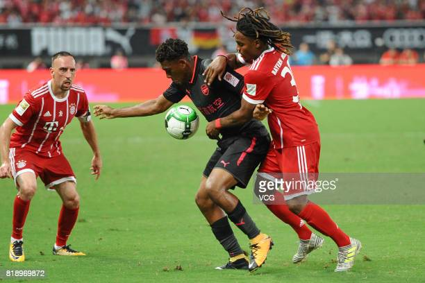 Renato Sanches of Bayern Muenchen and Alex Iwobi of Arsenal compete for the ball during 2017 International Champions Cup China between FC Bayern...