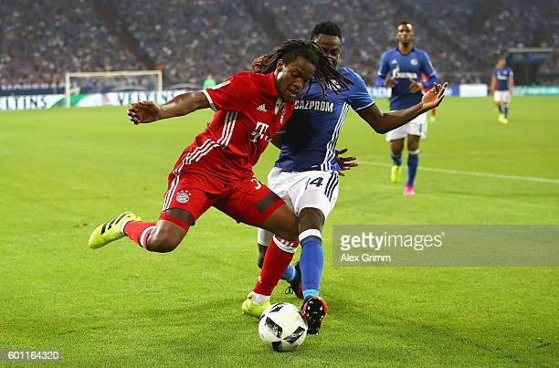 Renato Sanches of Bayern Muenchen and Baba Rahman of Schalke in action during the Bundesliga match between FC Schalke 04 and Bayern Muenchen at...