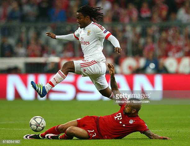 Renato Sanches of Benfica is tackled by Arturo Vidal of Bayern Munich during the UEFA Champions League quarter final first leg match between FC...