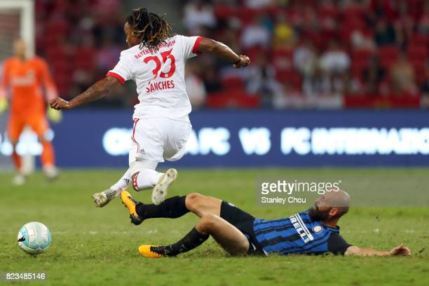 Renato Sanches of FC Bayern is tackled by Borja Valero of FC Internzionale during the International Champions Cup match between FC Bayern and FC...