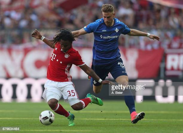 Renato Sanches of FC Bayern Muenchen fights for the ball with Felix Platte of SV Darmstadt during the Bundesliga match between Bayern Muenchen and SV...