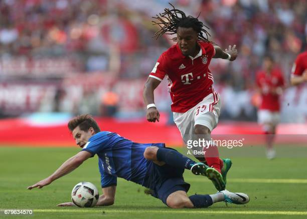 Renato Sanches of FC Bayern Muenchen fights for the ball with Sandro Sirigu of SV Darmstadt during the Bundesliga match between Bayern Muenchen and...