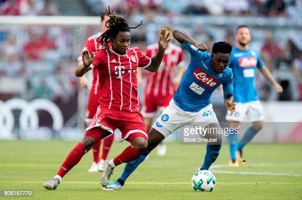 Renato Sanches of FC Bayern Muenchen is challenged by Amadou Diawara of SSC Napoli during the Audi Cup 2017 match between SSC Napoli and FC Bayern...