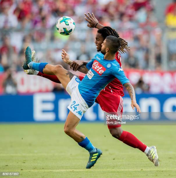 Renato Sanches of FC Bayern Muenchen is challenged by Lorenzo Insigne of SSC Napoli during the Audi Cup 2017 match between SSC Napoli and FC Bayern...