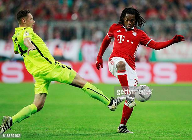 Renato Sanches of Muenchen and Dominik Kohr of Augsburg battle for the ball during the DFB Cup second round match between Bayern Muenchen and FC...