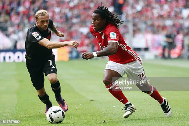 Renato Sanches of Muenchen is challenged by Marcel Risse of Koeln during the Bundesliga match between Bayern Muenchen and 1 FC Koeln at Allianz Arena...