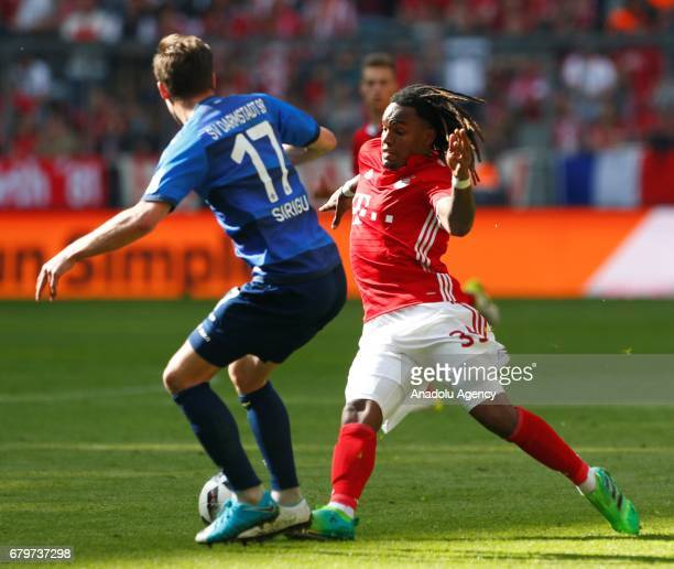 Renato Sanches of Munich and Sandro Sirigu of Darmstadt vie for the ball during the Bundesliga soccer match between Bayern Munich and SV Darmstadt 98...