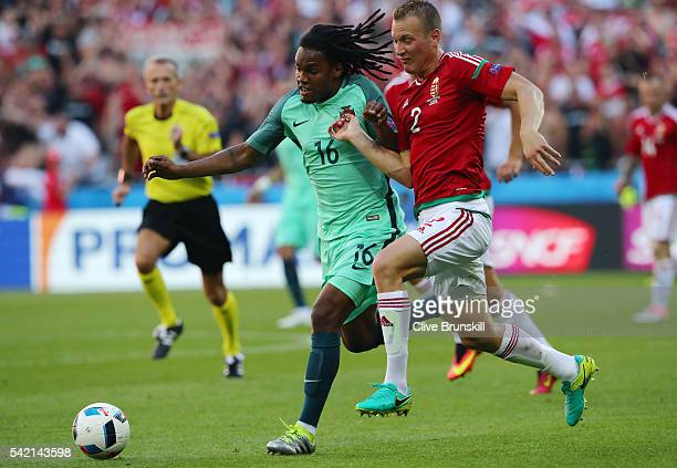 Renato Sanches of Portugal and Adam Lang of Hungary compete for the ball during the UEFA EURO 2016 Group F match between Hungary and Portugal at...