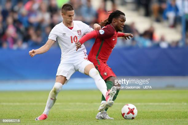 Renato Sanches of Portugal and Mijat Gacinovic of Serbia during their UEFA European Under21 Championship match on June 17 2017 in Bydgoszcz Poland