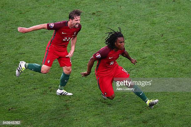 Renato Sanches of Portugal celebrates scoring his team's first goal with his team mate Adrien Silva during the UEFA EURO 2016 quarter final match...