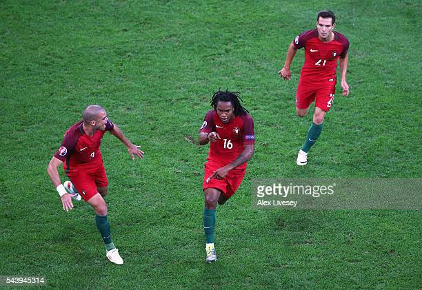 Renato Sanches of Portugal celebrates scoring his team's first goal with his team mates Pepe and Cedric Soares during the UEFA EURO 2016 quarter...