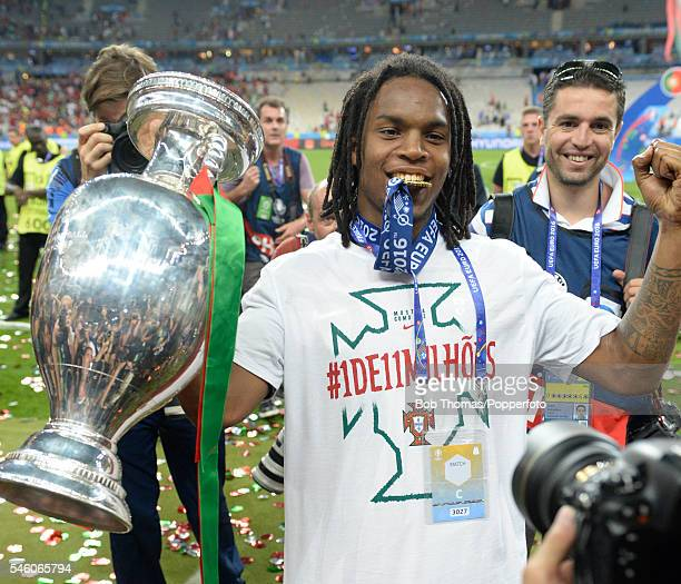 Renato Sanches of Portugal celebrates with the trophy after the UEFA EURO 2016 Final match between Portugal and France at Stade de France on July 10...