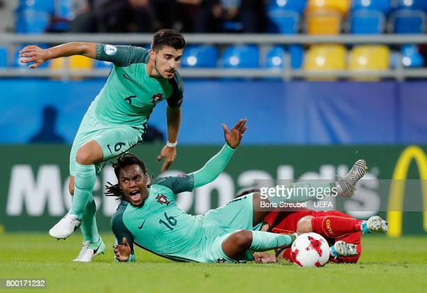 Renato Sanches of Portugal is tackled by Jovan Popzlatanov of FYR Macedonia during the UEFA European Under21 Championship Group B match between...