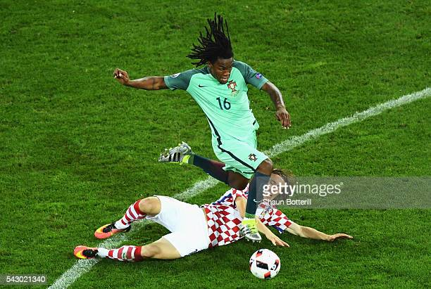 Renato Sanches of Portugal is tackled by Luka Modric of Croatia during the UEFA EURO 2016 round of 16 match between Croatia and Portugal at Stade...