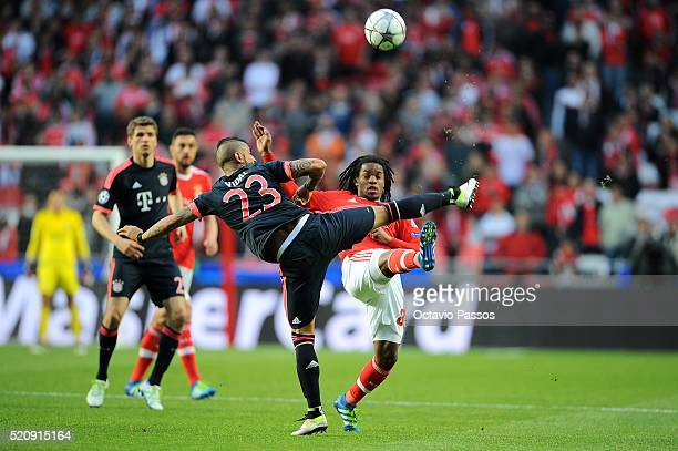 Renato Sanches of SL Benfica challenges Arturo Vidal of FC Bayern Muenchen during the UEFA Champions league Quarter Final Second Leg match between SL...