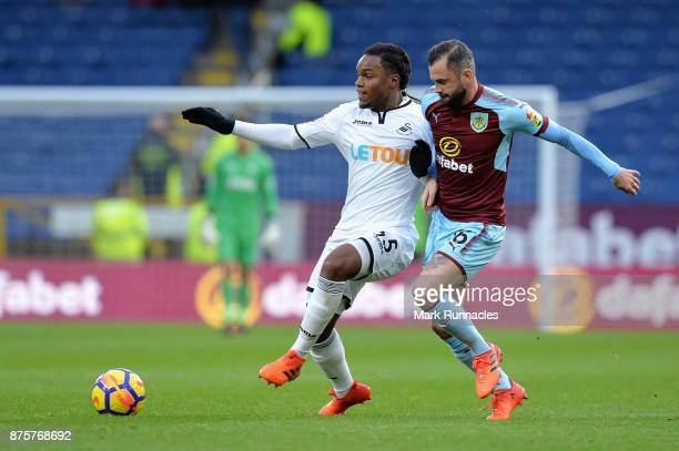 Renato Sanches of Swansea City and Steven Defour of Burnley compete for the ball during the Premier League match between Burnley and Swansea City at...