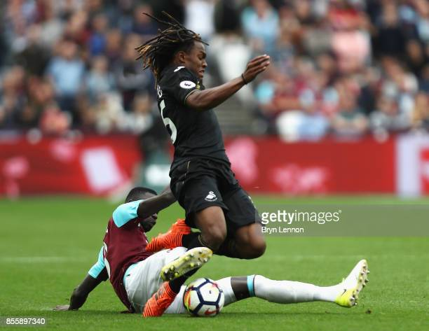 Renato Sanches of Swansea City is tackled by Cheikhou Kouyate of West Ham United during the Premier League match between West Ham United and Swansea...